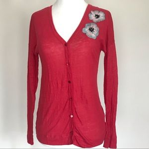 Red cardigan with floral design